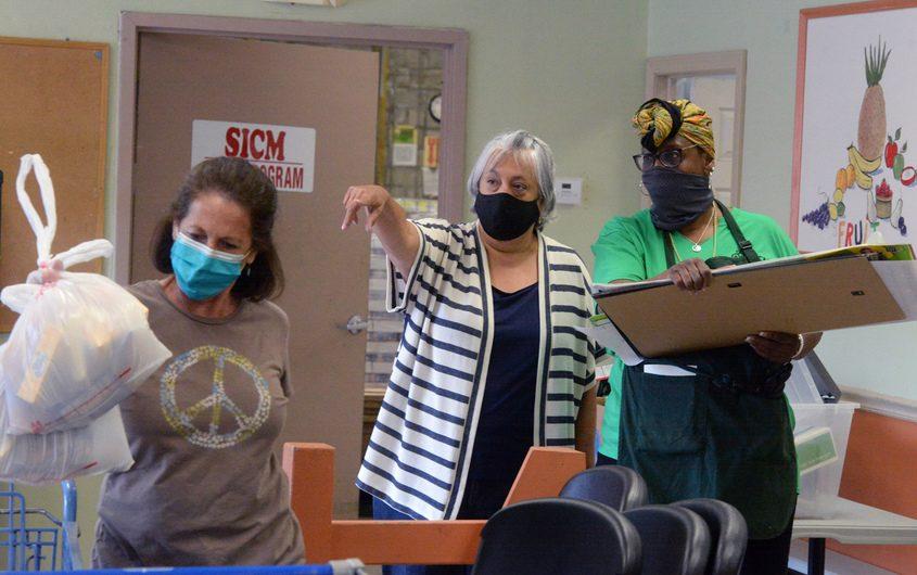 SiCM Executive Director Jo-Anne Rafalik, center, with volunteers Sue McKinney, left, and Pearl Tucker Hunter.