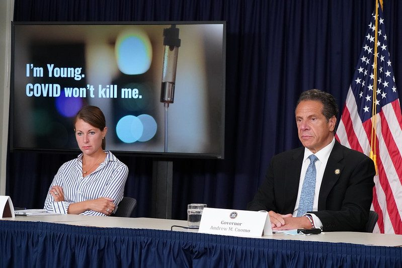 Gov. Andrew Cuomo screens an ad aimed at young New Yorkers on Thursday.