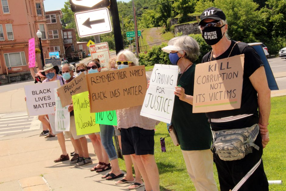A group of Black Lives Matter supporters lined Church Street in Wagner Square, Canajoharie, Saturday afternoon.