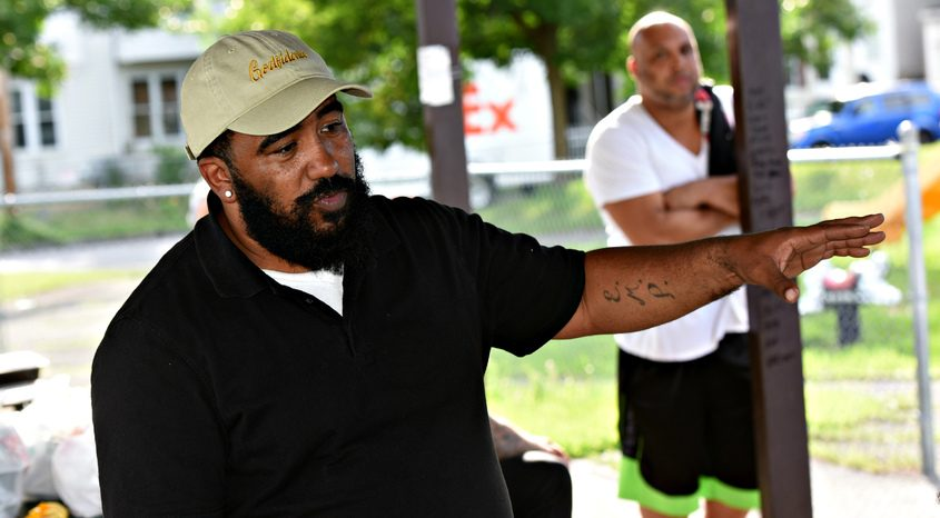William Rivas speaks in the Jerry Burrell Park during a community meeting to address gun violence Tuesday