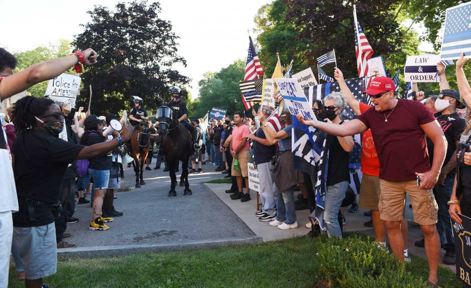All of Us BLM protesters shout chants during Back the Blue Rally in Saratoga Springs' Congress Park, July 30, 2020.