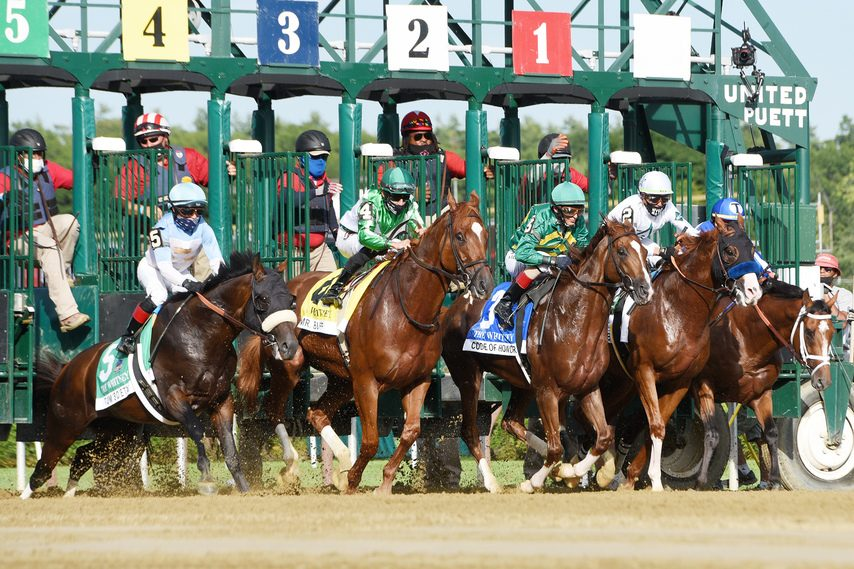 Tom's d'Etat, left, stumbles out of the gate at the start of the Whitney, won by Improbable, second from right.