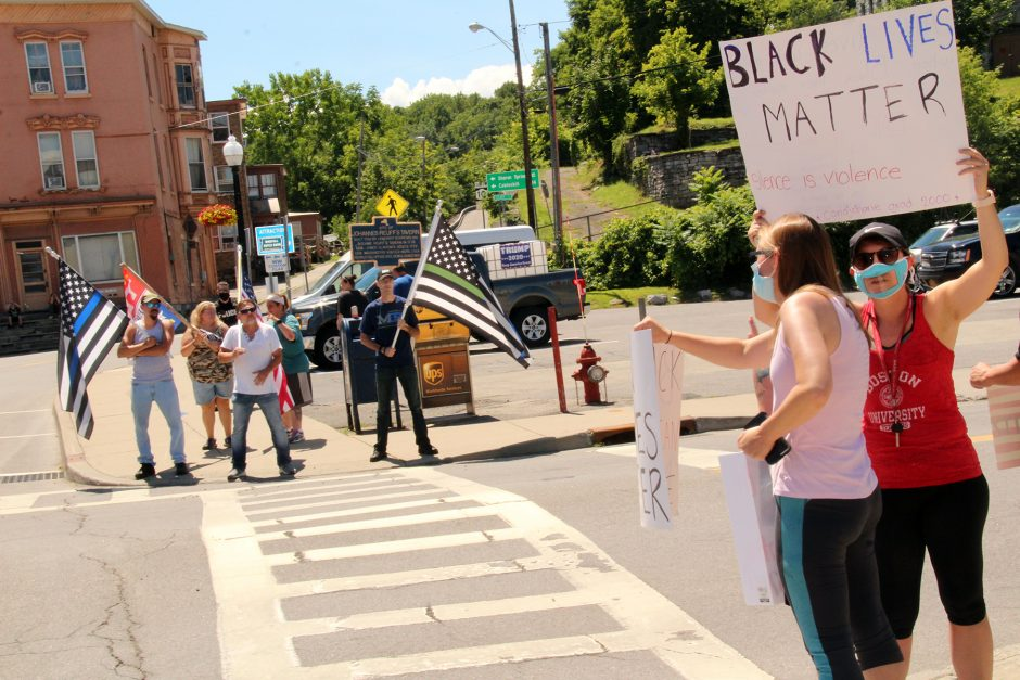 Black Lives Matter protesters (at right) counter Back the Blue protesters in Wagner Square, Canajoharie Saturday.