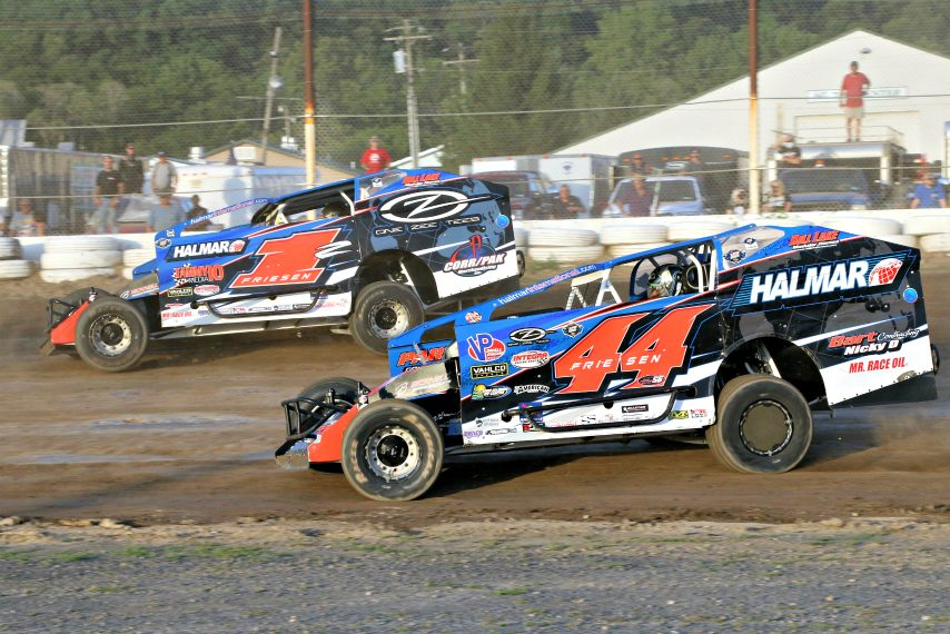 Stewart Friesen (44) races his wife Jessica Friesen (1Z) in the modified division Saturday at Fonda Speedway.