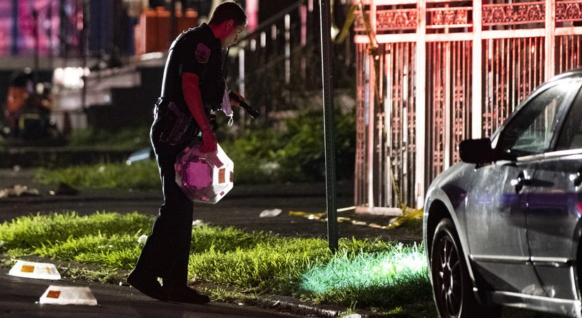 Shell casings are covered with evidence markers on Sixth Avenue in Schenectady Sunday night
