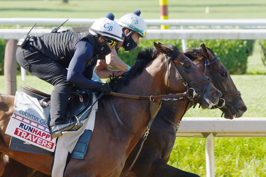 Country Grammer, left, breezes in company at Saratoga on Saturday morning.