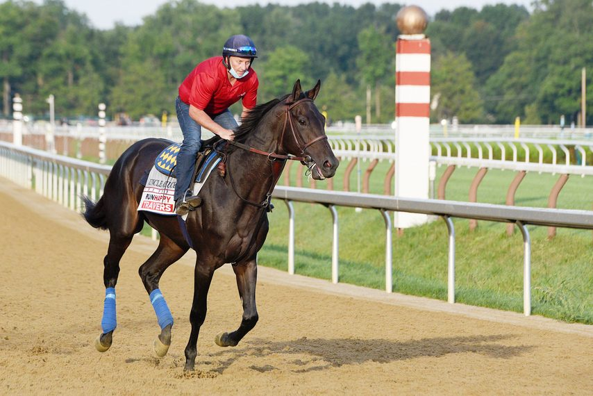 Uncle Chuck goes for an easy gallop under Simon Harris at Saratoga on Thursday morning.