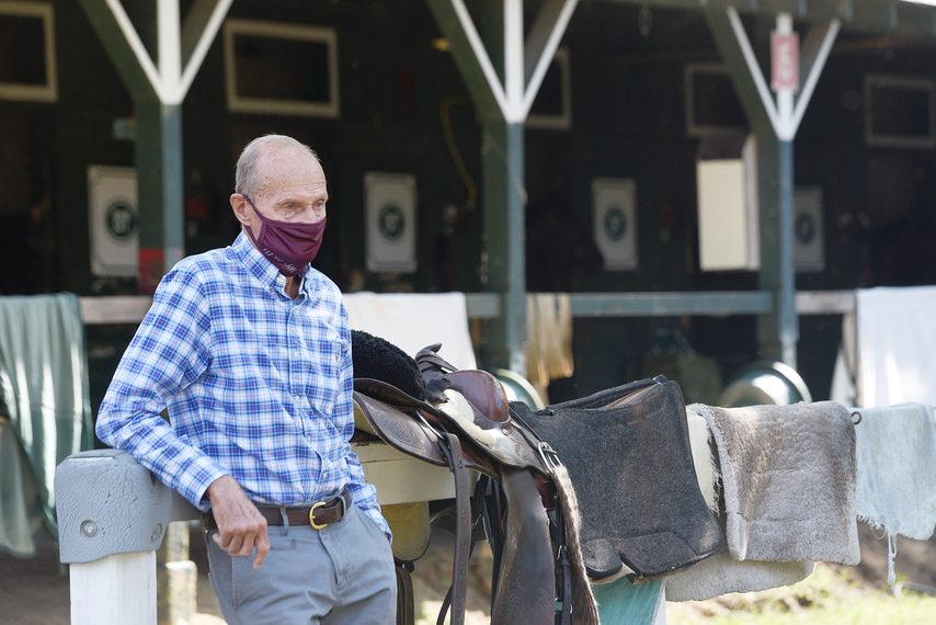 Trainer Barclay Tagg keeps an eye on things at his barn on the Saratoga backstretch.