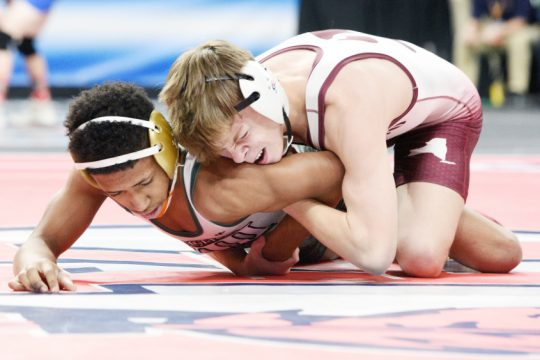 Shenendehowa's Stevo Poulin competes against Long Beach's Kevin Lopez in Div. I 113 pound state tournament match.