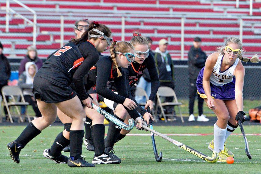 Johnstown field hockey player Taryn Ringer takes on the Schuylerville defense last November.