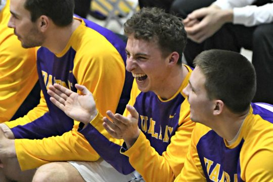 University at Albany basketball's Nick Fruscio cheers from the bench during a Feb. 5 game at SEFCU Arena.