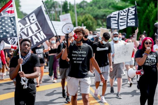 The march in Clifton Park on July 25 is shown.