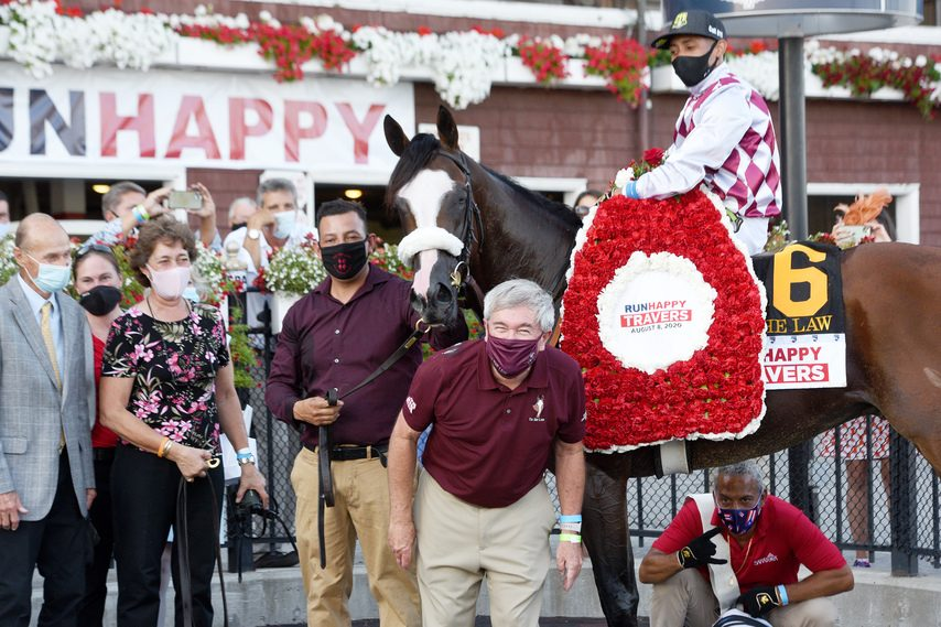 Tiz the Law and Sackatoga Stable pose for their photo in the winner's circle after his victory in the 151st Travers at Saratoga.