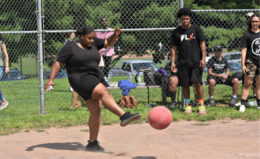 Saidah Champion gives the ball a ride Sunday afternoon at Collins Park during the BLX Collective Kick[ball] the Violence event