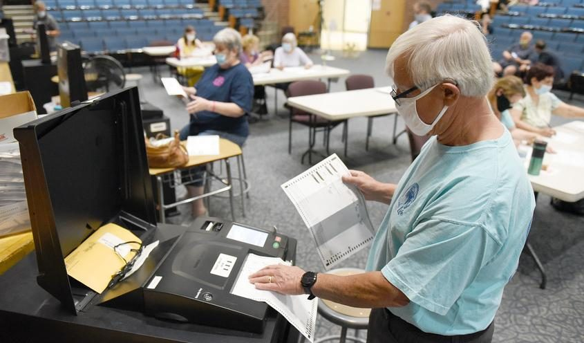 School vote counting in Saratoga Springs in June. By Erica Miller/Gazette