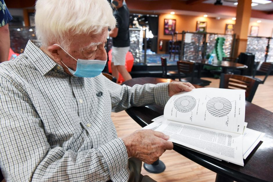 Jospeh Gentiluomo of Schenectady, who patented the modern bowling ball, looks at a ball design at Spare Time Clifton Park.