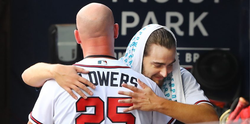 Atlanta Braves pitcher and Shenendehowa graduate Ian Anderson embraces catcher Tyler Flowers after his MLB debut Wednesday. Curtis Compton/Atlanta Journal-Constitution/TNS