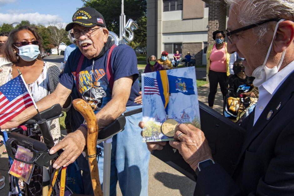 Senator Tedisco presents veteran Ambrose 'Cowboy' Anderson the New York State Liberty medal in Gloversville Friday.