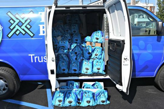A TrustCo Bank mobile van holds 450 'Trust' backpacks with school supplies headed for Pleasant Valley Elementary School. Photo by Stan Hudy/Staff