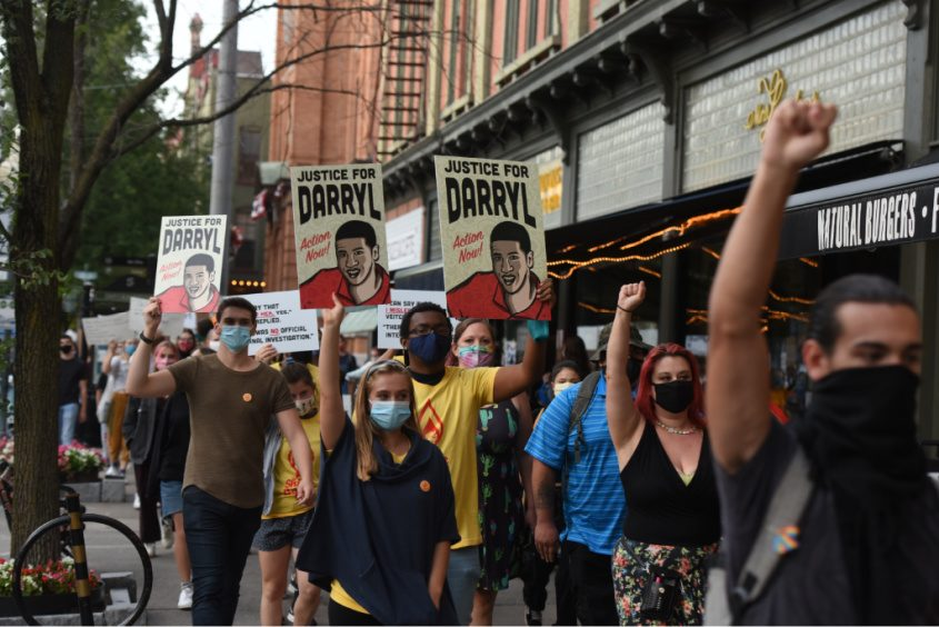 Protestors march silently down Broadway in Saratoga Springs during a protest in the memory of Darryl Mount, Jr. Photo by Stan Hudy/Staff