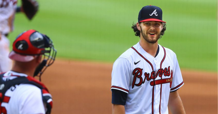 Atlanta Braves pitcher and Shenendehowa High School graduate Ian Anderson smiles at catcher Tyler Flowers last Wednesday.Curtis Compton/Atlanta Journal-Constitution/TNS