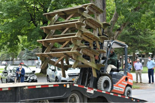 A stack of picnic tables from NYRA are loaded up on a flatbed destined for Saratoga Springs middle and high schools. Photo by Stan Hudy/Staff