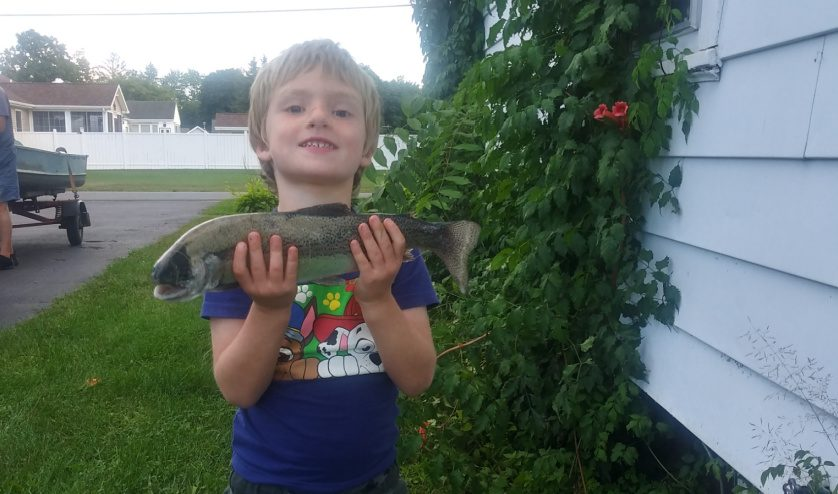 Four-year-old Zane Devendorf of Hudson Falls displays the 17-inch rainbow trout he recently caught.