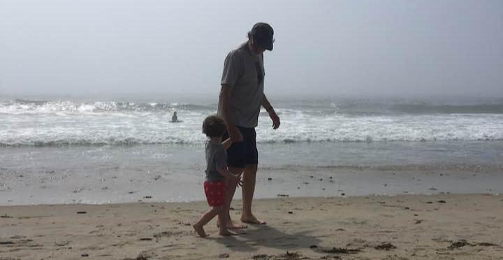 The writer's father and son on the beach in Maine over the summer