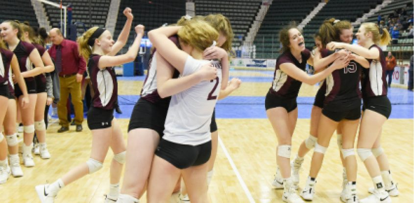 The Burnt Hills-Ballston Lake girls' volleyball team celebrate their Class A state championship over West Irondequoit last year.