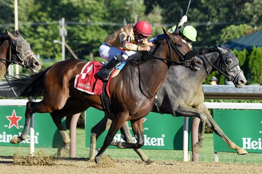 ERICA MILLER/Staff PhotographerMakingcents (1) and Luis Saez hold off Ice Princess, right, to win the Fleet Indian at Saratoga.
