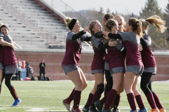 The Stillwater girls' soccer team celebrates after Paige Brinsko's goal in the state Class C title game Nov. 17.