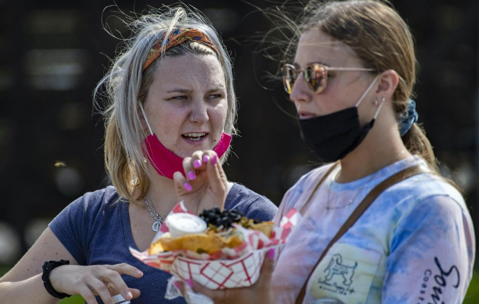 Cassidy Dopp, 19, and Hannah Wozniak, 20, enjoy a scaled-down version of the Fonda Fair on Friday.