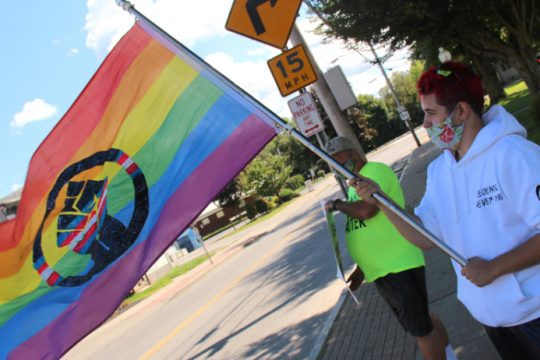 Black Lives Matter Rally Organizer Mason Rogers shows support for the LGBTQ+ community Saturday in Haslett Park.