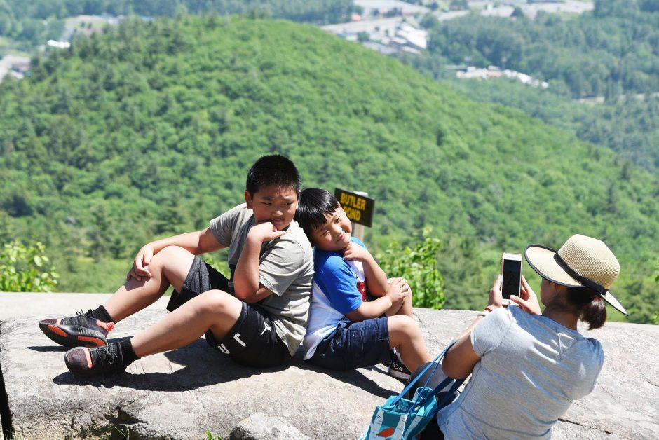 William and John Henry Zhang of Clifton Park pose for a photograph at the top of Prospect Mountain on June 9, 2019. Photo by Erica Miller/Staff