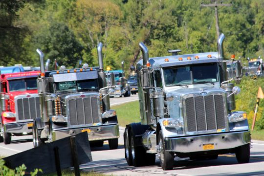 Trucks make their way toward the Fonda Fairgrounds during Sunday's Convoy for a Cause. Photo by Joshua Thomas/Staff