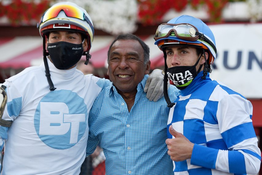 Irad Ortiz, right, the 2020 Saratoga riding champ, shares the moment with his brother Jose, left, and Angel Cordero.