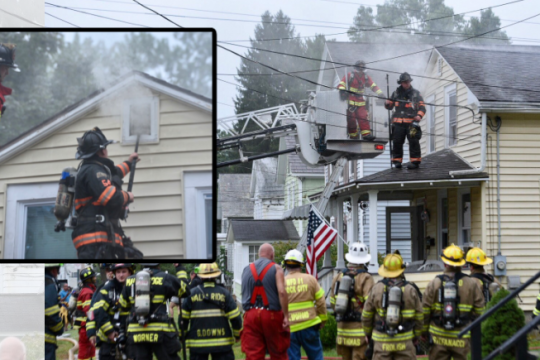 Firefighters at the scene Sunday. Credit: Erica Miller/Staff Photographer