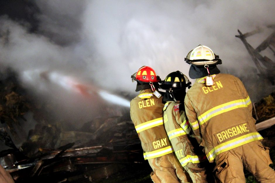 Firefighters from several departments battle a blaze at Ridgedale Farm in Ames Thursday evening.