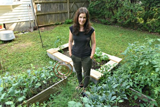 Mary Bufkins stands among her backyard garden on Northern Pines Road in Wilton. Sept. 9, 2020.
