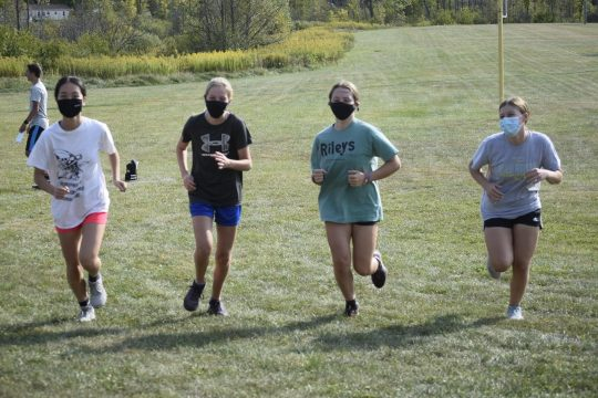 From left: Ayaka Sasaki, Cole Krempa, Emily Pertell and Lucy LoDestro run during cross country practice on Tuesday at Johnstown High School. The four are all field hockey players who are running cross country this fall due to the Foothills Council postponing field hockey to the Fall II season in March. (Adam Shinder/Staff Writer)