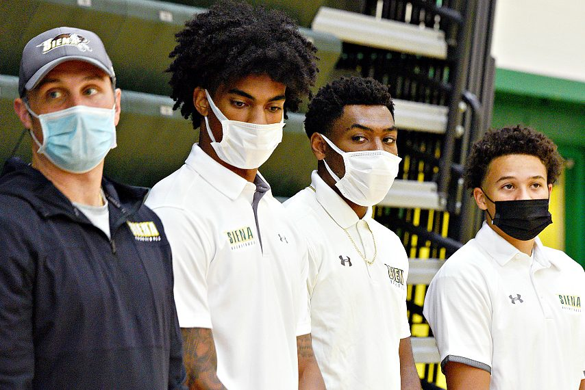 From left, Siena head coach Carmen Maciariello and players Manny Camper, Jalen Pickett and Jordan King are shown at an event on campus last week. (Erica Miller)