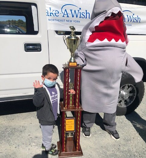 Five-year-old Brady Bell of Latham stands next to the trophy he received for winning the 22nd annual Make-A-Wish fishing contest. (Ed Noonan photo)