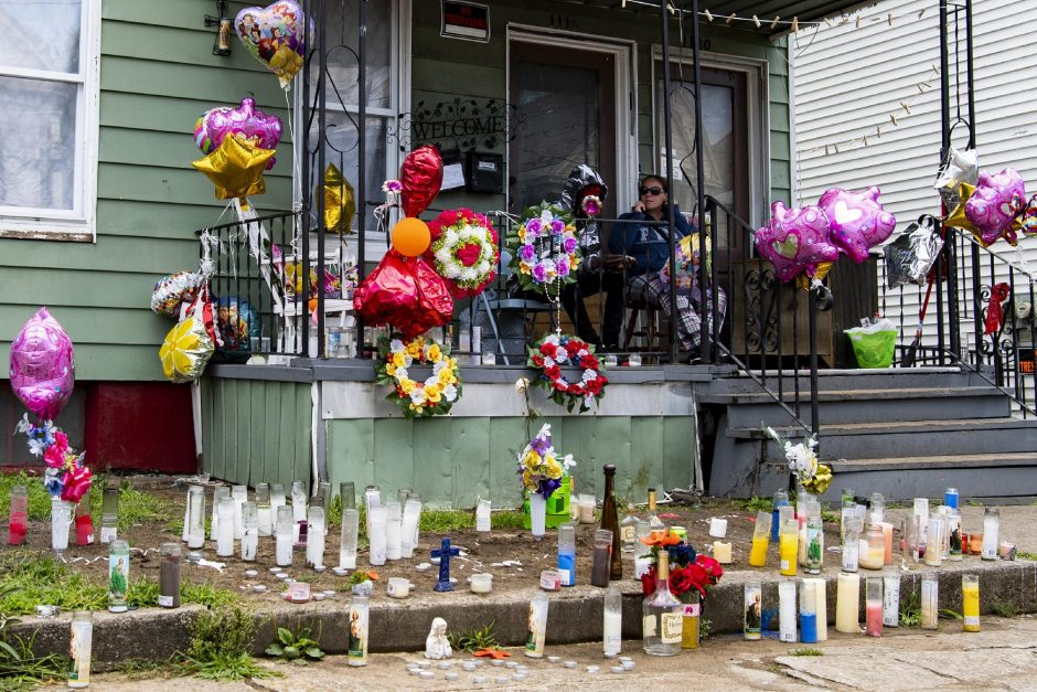 Candles and balloons cover the front of 1118 6th Avenue on Friday, Aug. 7, 2020, where Jennifer Ostrander was killed on Sunday, Aug. 2, 2020.
