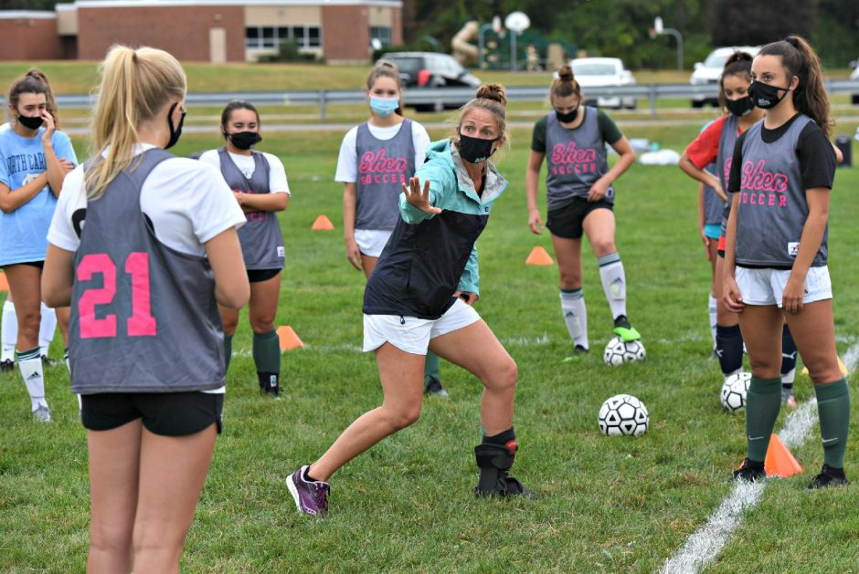 STAN HUDY/STAFF REPORTERShenendehowa girls' soccer coach Holli Nirsberger demonstrates a drill during a practice on Thursday.