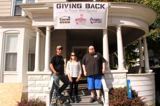 Disabled veteran John Christman, right, is pictured at his West Main Street home in St. Johnsville Thursday. With him are Correll Contracting Corp. co-owners Kyle Horton and Marrissa Rubscha-Horton.