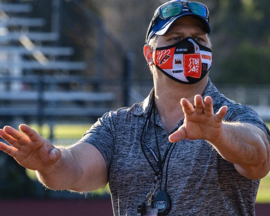PETER R. BARBER/STAFF PHOTOGRAPHERMohonasen head football coach Joe Gallo runs his players through practice drills on Thursday at Mohonasen High School.