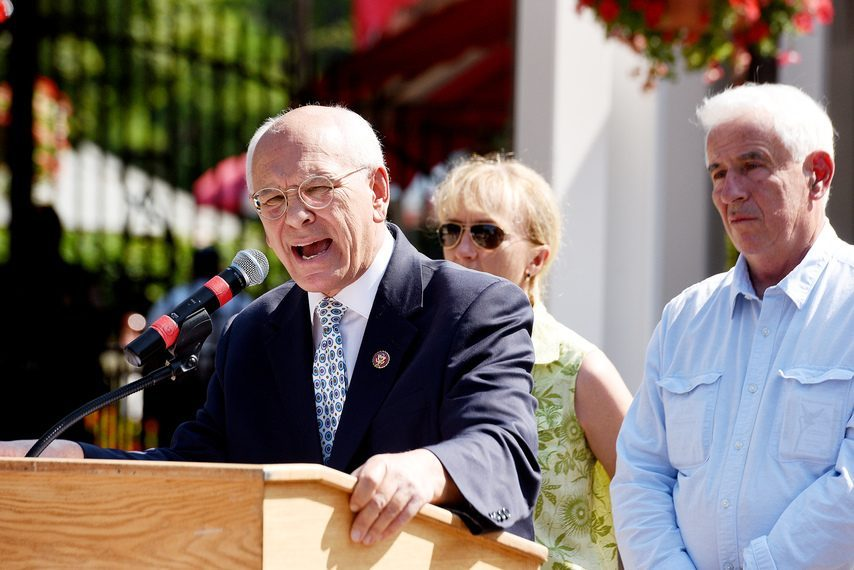 Rep. Paul Tonko speaks outside the clubhouse entrance regarding the Horseracing Integrity Act, with horse racing supports behind, at Saratoga Race Course in Saratoga Springs on Thursday, August 1, 2019.