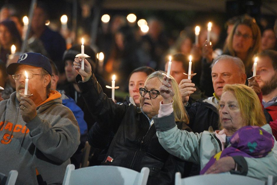 Friends and family members hold candles, pray and sing on Oct. 6, 2019, at the Mohawk Valley Gateway Overlook in Amsterdam during the one-year memorial tribute to those who died in the Schoharie limousine crash in 2018. (Gazette file photo)