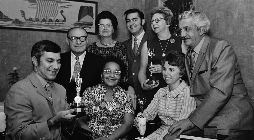 Long-tenured employees of the Mr. James Inc. beauty salon were honored for their longevity during a gatherings of employees and company officials at The Vikings restaurant in October 1970. Seated from left are Vito Scolamiero; James Scolamiero (company president);  Hettie Browning; Marion Sorbello; and John Ciccarelli. Standing from left are Helen Vinosky, Michael Scolamiero of Mr. James branch salon House of Gemini in Clifton Park; and Norma Martin. The company started in the hairstyling business in 1920.