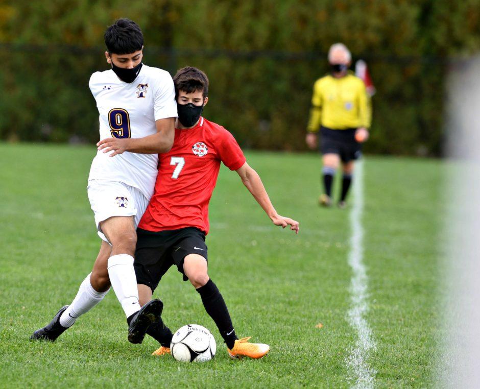 Niskayuna junior Matt Stiles (7) battles Troy's Hamza Ahmadzai (9) during the 2020 Suburban Council league opener for soccer at Niskayuna High School. Oct. 3, 2020. (Stan Hudy/Staff Writer)